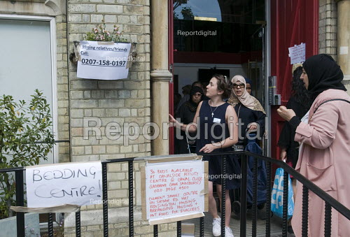 Grenfell Tower Fire. Emily a volunteer helping local residents as they bring donations to Notting Hill Methodist Church one of the Relief Centres set up just a few hundred metres from Grenfell Tower to help victims of the disaster many of whom lost everything they own from their homes in the fire that engulfed the tower block overnight - Stefano Cagnoni - 2017-06-14