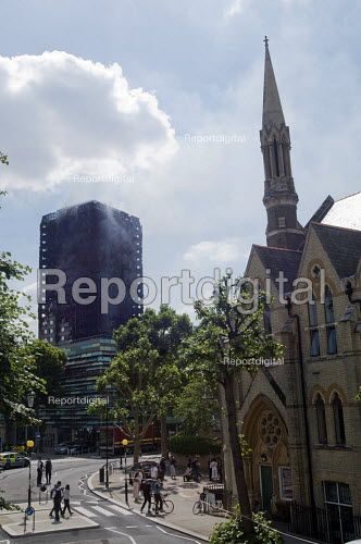 Grenfell Tower Fire. Notting Hill Methodist Church one of the Relief Centres set up close to Grenfell Tower seen with smoke still coming from it to help victims of the disaster many of whom lost everything they own from their homes in the fire that engulfed the tower block overnight - Stefano Cagnoni - 2017-06-14
