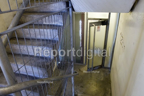 Exterior fire door wedged open by faulty flooring on the Emergency Fire Exit stairwell on the Twelfth floor of Blashford Tower. Blashford Tower is one of the five towers at the Chalcot Estate, Camden, which have been refurbished by Rydon with exterior cladding as was fitted to Grenfell Tower - Stefano Cagnoni - 2017-06-15