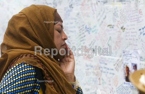 Local resident thinking of those lost, Wall of condolence a few hundred metres from the Grenfell Tower fire filled with messages of love and solidarity in memory of the victims of the tragedy, London - Stefano Cagnoni - 2017-06-16
