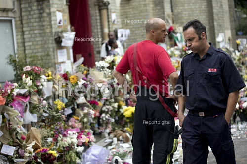 LFB Firefighters with the floral tributes and missing posters for the victims Grenfell Tower Fire, West London. - Jess Hurd - 2017-06-22