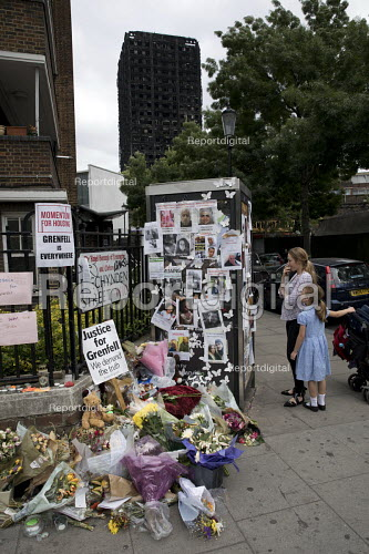 Floral tributes and missing posters for the victims Grenfell Tower Fire, West London. - Jess Hurd - 2017-06-22
