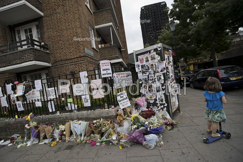 Children with floral tributes and missing posters for the victims Grenfell Tower Fire, West London. - Jess Hurd - 2017-06-22