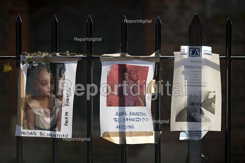 Floweral tributes and missing posters for the victims Grenfell Tower Fire, West London. - Jess Hurd - 2017-06-22