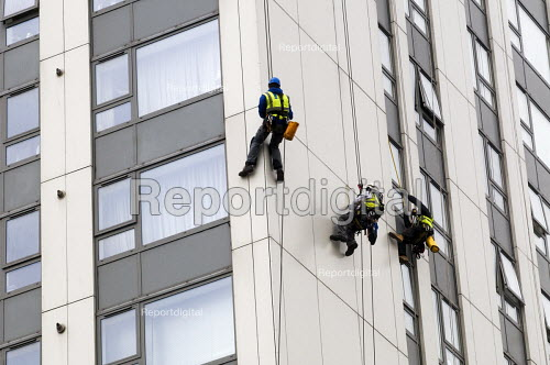 Contractors measuring and inspecting external panels on Bray Tower one of the five towers in Chalcot Estate, Camden, London, all of which have been refurbished using exterior cladding which now has to be urgently replaced as it is proven unsafe following the Grenfell Tower Fire - Stefano Cagnoni - 2017-06-27