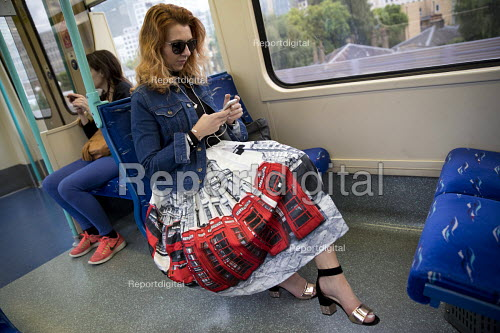 Passenger with an iconic telephone box skirt on a DLR train, Canary Wharf, London - Jess Hurd - 2017-06-30