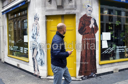 Mural on side of a cafe of Theresa May as Marilyn Monroe and Jeremy Corbyn caricatured as St Francis of Assisi by street artist Loretto, Fitzrovia, London - Stefano Cagnoni - 2017-07-01