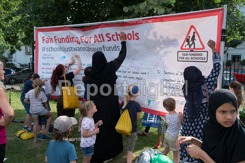 Children and parents writing a Fair Funding for All Schools banner Camden NUT rally to oppose cuts to school funding, Kentish Town, London - Philip Wolmuth - 2017-07-04