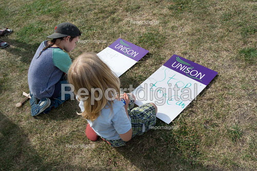 Stop the Cuts. Children making Unison placards, Camden NUT rally against cuts to school funding, Kentish Town, London - Philip Wolmuth - 2017-07-04