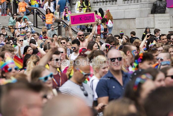 Fuck the DUP placard, Pride in London, Love Happens Here, Trafalgar Square, London. - Jess Hurd - 2017-07-08