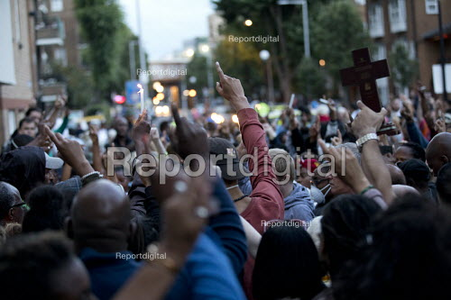 Grenfell Tower Fire vigil, one finger to represent oneness, one month after the fire, London - Jess Hurd - 2017-07-12