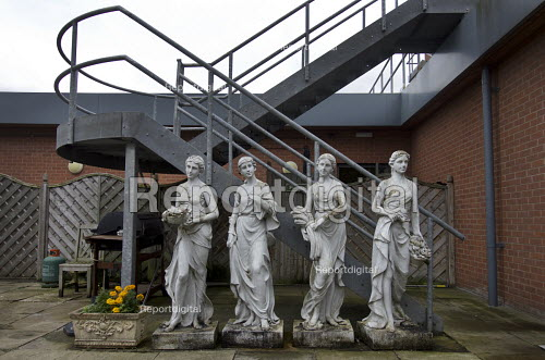 Four Seasons garden scuplture set and fire escape, Spring, Summer, Autumn and Winter. Each season is represented as an allegorical figure bearing traditional iconographic symbols. Wildmoor Spa And health club, Stratford upon Avon, Warwickshire - John Harris - 2017-07-22