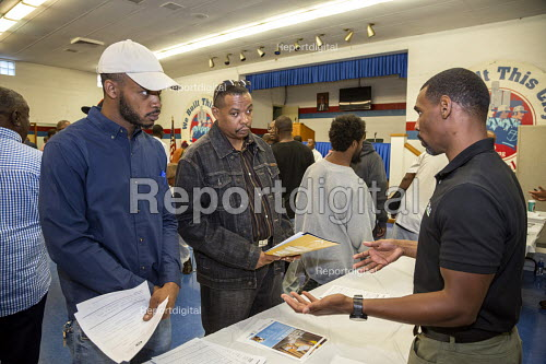 """Detroit, Michigan USA Job seekers at a UAW union hall job fair """"Expungements, Pardons and Jobs. Companies billed as """"ex-felon friendly"""" attending. Ex prisoners find it difficult to find work because of past prison records. Companies billed as """"ex-felon friendly"""" talked to job seekers. Not everyone attending the job fair has a criminal record. - Jim West - 2017-08-05"""
