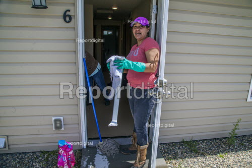 Wapato, Washington, USA Accommodation to house Mexican contract workers brought into USA under the H2A visa program. Workers live in the barracks and work several months but must return home after the work contract is finished. Monsen Fruit Company. Women cleaning the barracks in preparation for the arrival of the workers - David Bacon - 2017-05-02