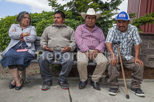 Burlington, Washington, USA Members of Familias Unidas por la Justicia waiting to sign a contract negotiated with Sakuma Brothers Farms, with Danny Weeden, general manager of the company, after four years of strikes and boycotts - David Bacon - 2017-06-16