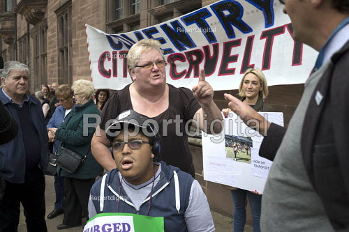 Parents of children with disabilities lobbying Coventry Labour Council against cuts to, and charges for, school transport, Coventry. Lcbour Councillor Kevin Maton arguing with a protestor. The Council is to approve a decision to spend 11 million buying an upmarket hotel - John Harris - 2017-10-10