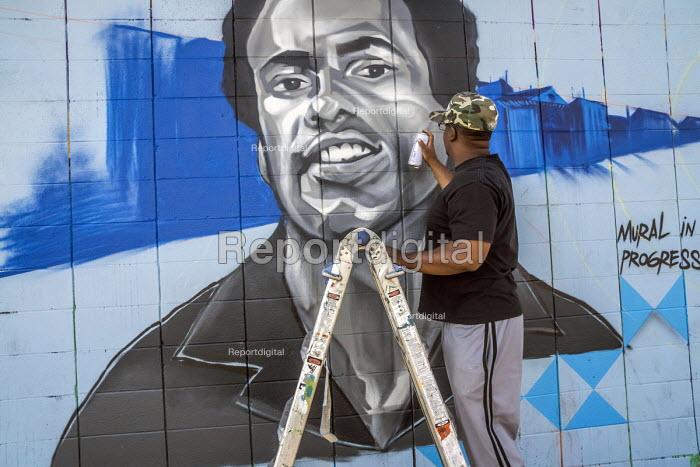 Report digital oakland california usa artists for Black panther mural
