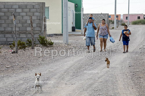 Boquillas del Carmen, Coahuila, Mexico, A family walking along a dusty street in the small border town - Jim West - 2017-11-05