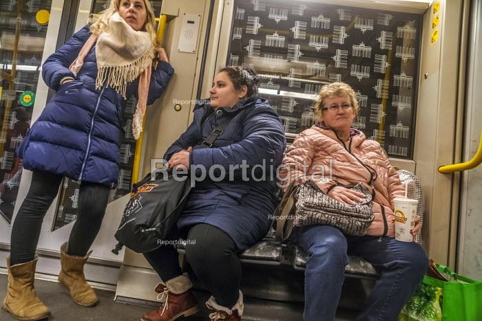 Passengers on a Berlin underground train or U-Bahn, Germany - David Bacon - 2017-12-01