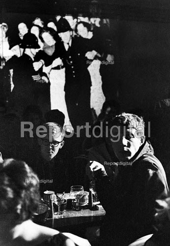 Comedians and satirists Jonathan MIller (R) and Alan Bennett (L), opening of The Establishment London 1961. The Establishment Club was created by Peter Cook and Nicholas Luard in Greek Street in the West End of London performing biting satire aimed at the ruling political classes - Romano Cagnoni - 1961-10-20