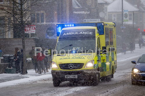 An ambulance on the snow covered streets of Bristol. - Paul Box - 2018-03-01