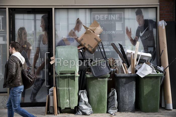 Rubbish piled up outside a personal training studio, Define London, Fitzrovia, London - Jess Hurd - 2018-03-05