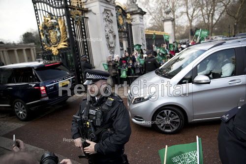 School children welcoming Saudi Prince Mohammed Bin Salman outside Buckingham Palace where he was to lunch with the Queen. The pupils are from The King Fahad Academy School, London. Armed Police guarding the gates - Jess Hurd - 2018-03-07