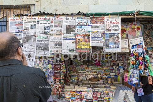 Oaxaca, Mexico Man reading the headlines of the many newspapers on display for sale at a newsstand - Jim West - 2018-02-20