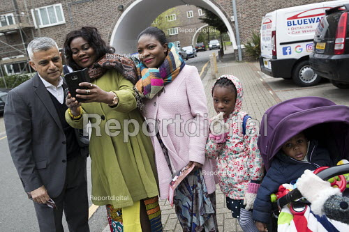 Sadiq Khan selfie with a family going to church, Labour Party local election campaign, Earlsfield ward, Wandsworth, London - Jess Hurd - 2018-04-29