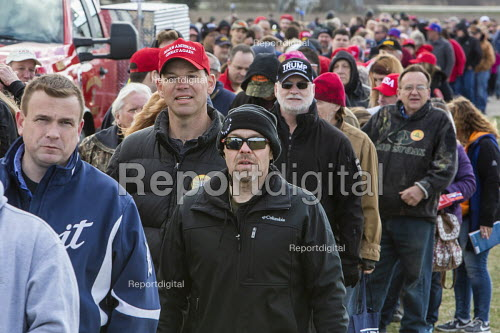 Washington Township, Michigan USA - 28 April 2018 - People wait in a long line for security clearance before a Donald Trump campaign rally in Macomb County, Michigan. Trump skipped the annual White House Correspondents' Association dinner to travel to Michigan. - Jim West - 2018-04-28