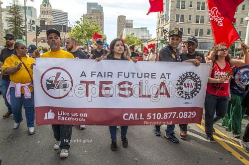 California, USA: Tesla UAW workers with community, immigrant rights organizations march through Oakland to celebrating May Day - David Bacon - 2018-05-01