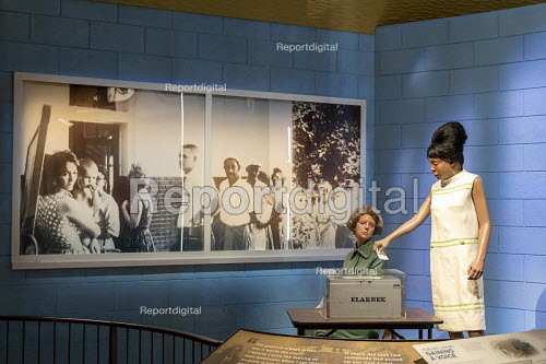 Jackson, Mississippi, USA: The Museum of Mississippi History. A voting rights display showing an African American casting a ballot as a white poll worker watches. Most African Americans in Mississippi were denied the right to vote until the passage of the national Voting Rights Act in 1965 - Jim West - 2018-04-24