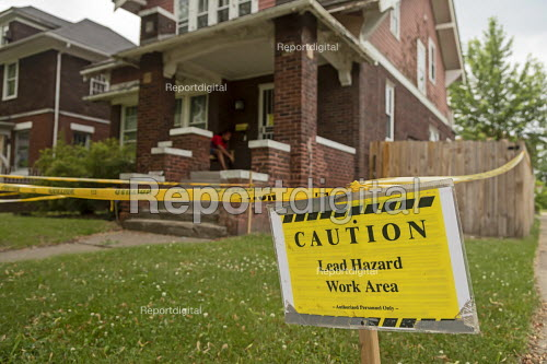 Detroit, Michigan, USA: A sign warning of a lead hazard outside a house. Children are particularly vulnerable to lead poisoning. The number of children with elevated blood levels (EBLLs) in Detroit has decreased by about half since 2009 as corrective action has been taken. There are more than 125,000 lead service lines (LSLs) in the City of Detroit, LSLs are most likely to be found in family homes built before 1950 - Jim West - 2018-06-09