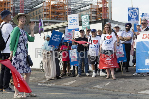 Unions and Keep Our NHS Public NHS 70th anniversary protest outside the unfinished Midland Metropolitan Hospital, construction of which stopped when Carillion went into liquidation. Ann Gallagher, community activist speaking - John Harris - 2018-07-05