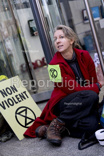 Dr Gail Bradbrook, co-founder, Extinction Rebellion glueing themselves to the Department of Energy, Westminster, London in protest against lack of Government action on climate change - Jess Hurd - 2018-11-12