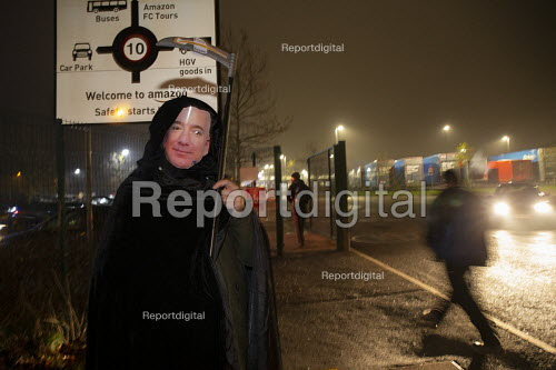 Jeff Bezos mask, Grim Reaper. Amazon workers protest against working conditions, Black Friday, Rugeley, Staffordshire - John Harris - 2018-11-23