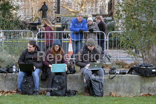 News photographers using laptops to file photos from the media area, College Green, Westminster, London, on the day Conservative MPs launched a leadership challenge - Philip Wolmuth - 2018-12-12