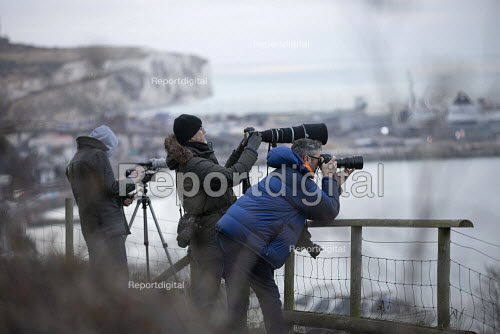 Press photographing the boarder patrol boat Searcher, looking for refugees crossing the Channel Channel from France, New Years Day, Port of Dover, Kent. - Jess Hurd - 2019-01-01