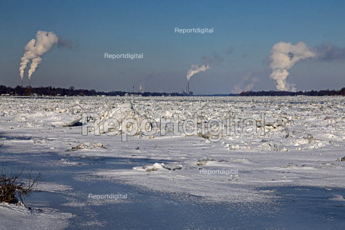Marine City, Michigan, USA: DTE Energy coal and oil fired power stations line the U.S. side (L) of the ice filled St. Clair River. The Canadian side has mostly refineries and chemical plants - Jim West - 2019-02-01