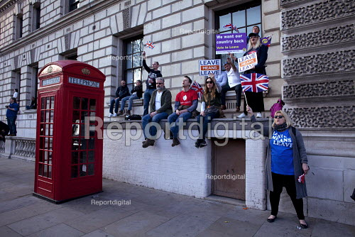 Pro Brexit protests on the day the UK was meant to leave the EU, Parliament Square, Westminster, London Sitting on the roof of a WW2 Air Raid Shelter - David Mansell - 2019-03-29
