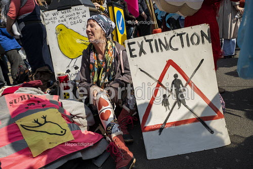 Extinction Rebellion protest Oxford Circus against lack of government action on climate change. Nonviolent direct action simultaneous blocking London - Jess Hurd - 2019-04-15