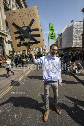 Middle Class protester, Extinction Rebellion protest, Oxford Circus against lack of government action on climate change. Nonviolent direct action simultaneous blocking London. - Jess Hurd - 2019-04-15