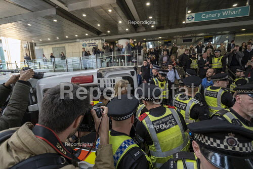 Extinction Rebellion stop DLR trains at Canary Wharf, against lack of government action on climate change. Nonviolent direct action blocking London - Jess Hurd - 2019-04-17