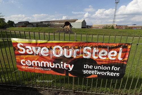 British Steel Scunthorpe. Community union Save Our Steel banner. Sculpture of molten slag being poured from a slag pot onto a waste tip. Greybull Capital has put British Steel into receivership. Lincolnshire - John Harris - 2019-05-22