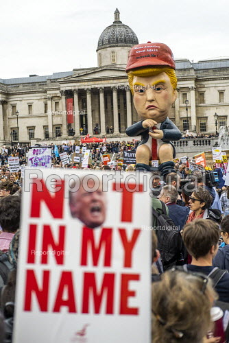 Marionette of President Trump sitting on a toilet tweeting, Together Against Trump, stop the state visit protest against Donald Trump, London - Jess Hurd - 2019-06-04