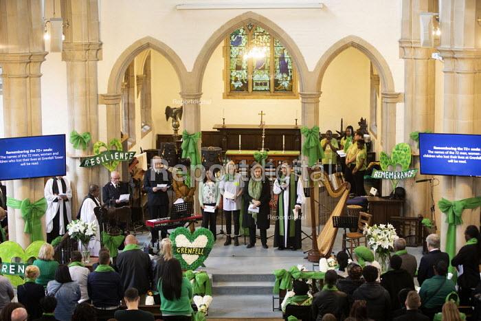 Emma Dent Coad MP reading the nams of the dead, Grenfell fire 2nd anniversary memorial service St Helen's Church, Kensington, London. - Jess Hurd - 2019-06-14