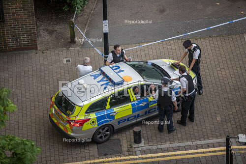 Stabbing crime scene with pool of blood visible on an E3 estate, Tower Hamlets, East London. - Jess Hurd - 2019-07-25