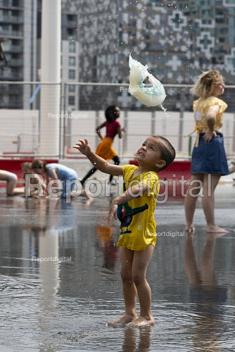 Heatwave. Nappy tossing. Children playing with water jets, Centenary Square, Birmingham, reflection pool with fountains - John Harris - 2019-07-25