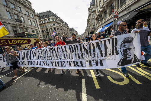 Free Tommy Robinson protest, BBC Portland Place, London. Banner claiming he is a political prisoner and jailed for journalism - Jess Hurd - 2019-08-03