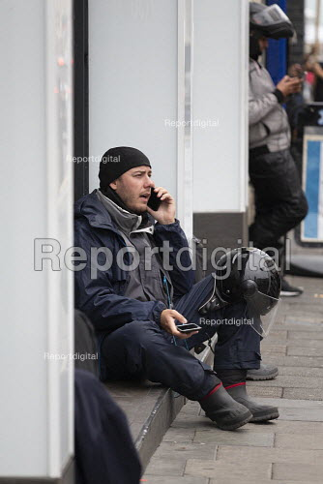 Uber Eats riders waiting for work, Brighton - John Harris - 2019-09-09